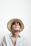 Young man in straw hat and sunglasses look up Stock Photography
