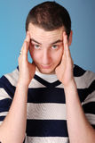 Young man with stress headache Stock Photography