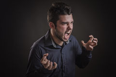 Young man is stressed out and screaming Stock Image