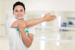 Young man stretching Stock Photos