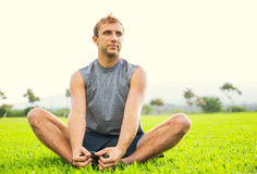 Young man stretching before exercise Stock Images