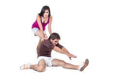 Young man stretching with female personal trainer Stock Photo
