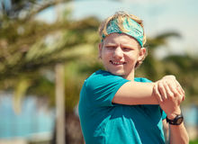 Young man stretching before jogging Stock Images