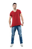 Young man stretching and showing red t-shirt blank copy space Royalty Free Stock Photos