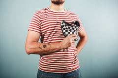 Young man in striped shirt and checkered hat Stock Photos