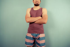 Young man in striped shorts with his arms crossed Royalty Free Stock Images