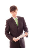 Young man in striped suit and tie holds document Stock Images