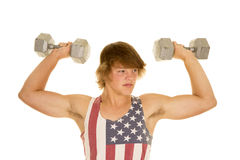 Young man in striped tank top weights flexed Royalty Free Stock Photography