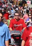 Young Man with Stroller in Crowd Stock Photo