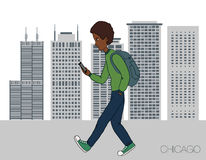 Young man strolling through the city with a mobile phone Stock Photos