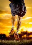 Young man strong legs off trail running at amazing summer sunset in sport and healthy lifestyle Stock Photo