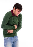 Young man with strong stomach pain royalty free stock images