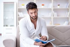 Young man student businessman reading a book studying working at Stock Images