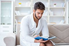 Young man student businessman reading a book studying working at Royalty Free Stock Photography