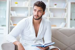 Young man student businessman reading a book studying working at Stock Photography