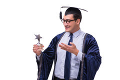 The young man student graduating isolated on white. Young man student graduating isolated on white Royalty Free Stock Photos