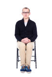 Young man student or office worker sitting on office chair isola. Ted on white background Stock Photos