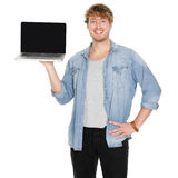 Young man student showing blank laptop screen. Young man student showing blank laptop computer screen smiling happy. Male university student or casual young man Stock Photos