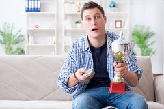 The young man student watching football at home. Young man student watching football at home Royalty Free Stock Photo