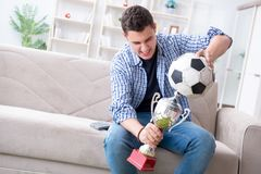 The young man student watching football at home. Young man student watching football at home Royalty Free Stock Photos