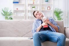 The young man student watching football at home. Young man student watching football at home Royalty Free Stock Images