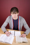 Young Man Studying. In a home environment Royalty Free Stock Photography