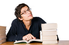Young man studying on books Royalty Free Stock Photos