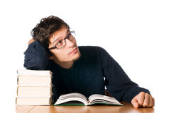 Young man studying on books Stock Photos