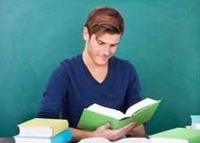 Young Man Studying In Classroom Royalty Free Stock Image