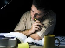 Young Man Studying at Night Royalty Free Stock Photos