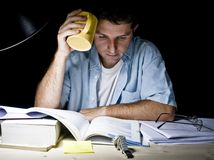 Young Man Studying at Night Royalty Free Stock Photography
