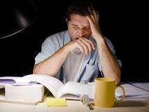 Young Man Studying at Night Stock Image