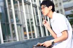 Young man studying at outdoor Stock Images