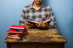 Young man studying Royalty Free Stock Photos