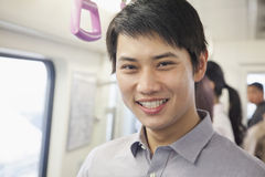 Young man in subway Stock Images
