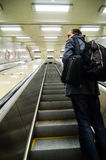 Young man on subway escalator Royalty Free Stock Photo
