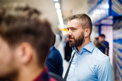Young man in subway stock image
