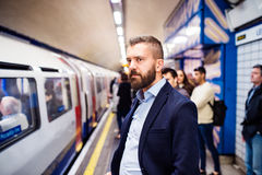 Young man in subway. Young handsome man standing on subway platform Royalty Free Stock Image