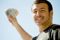 Successful young man. A young man successful look with money in hand Royalty Free Stock Photography