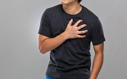 Young man suffer from heart attack Stock Photography