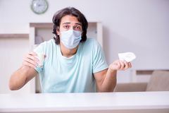 Young man suffering from allergy stock photos