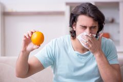 Young man suffering from allergy stock image