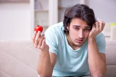 Young man suffering from allergy stock photo