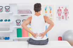 Young man suffering from back pain Royalty Free Stock Images