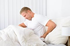 Young man suffering from backpain Stock Photography