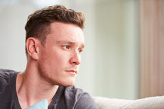 Young Man Suffering From Depression At Home Royalty Free Stock Photos