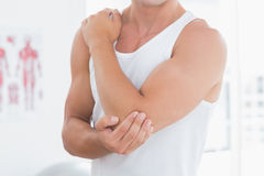 Young man suffering from elbow pain Royalty Free Stock Photo