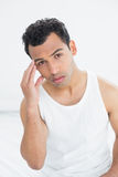 Young man suffering from headache in bed Royalty Free Stock Photos