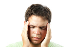 Young man suffering from a headache isolated Stock Photo