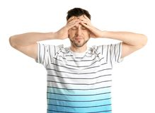 Young man suffering from headache. On white background Stock Image